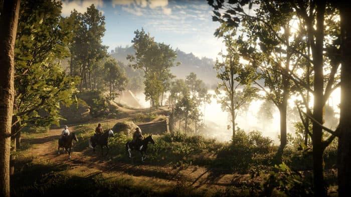 La bande d'Arthur Morgan chevauchant dans les bois dans Red Dead Redemption 2