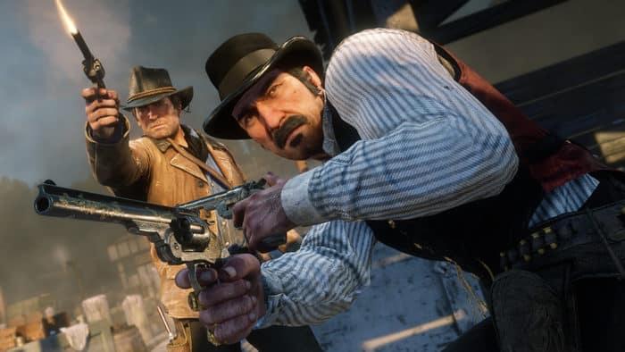 Dutch et Arthur en pleine fusillade dans Red Dead Redemption 2